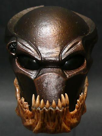 A mask decorated with the jawbone of the Predator's kill.