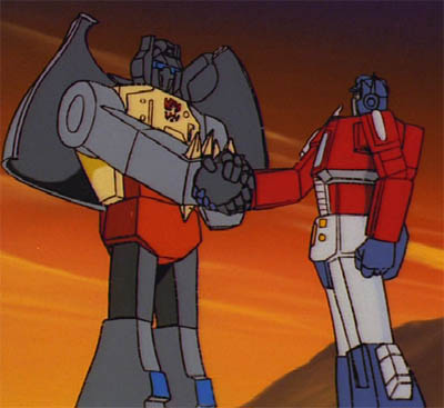 Grimlock in the G1 cartoon in robot mode, shaking hands with Optimus Prime