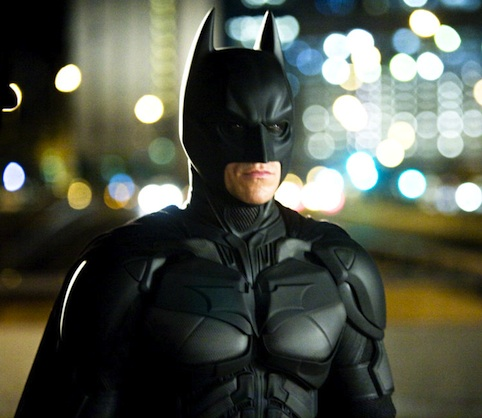 Batman has to be somewhat armored in a realistic universe. I'd like the Nolan look with more technology built into it to justify Batman's presence. IMO, it would be cool if his gauntlets allowed him to hack computers.