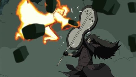 Madara repelling Naruto's attack.