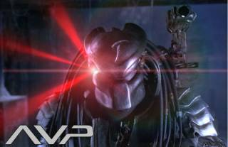 A Predator takes aim with its mask's targeting laser.