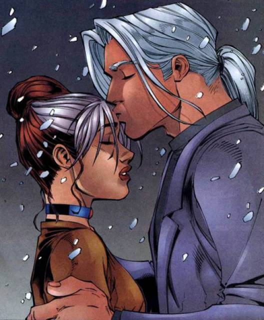 Joseph gives Rogue a Christmas kiss