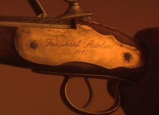 The inscription on the pistol.