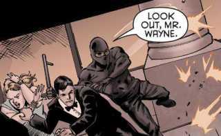 A masked Luke Fox saving Bruce Wayne from a line of gun fire.