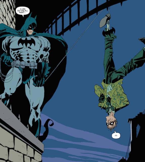 Batman interrogating the Riddler