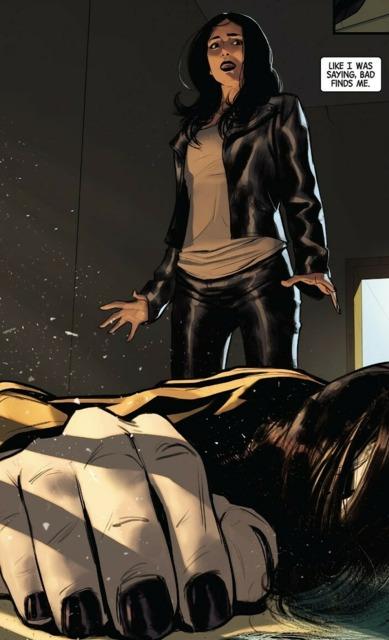 Jones standing over a corpse in her office