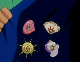 the Orange League Badges in the Anime