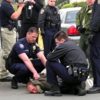 Uniformed officers apprehending and arresting a dangerous suspect.